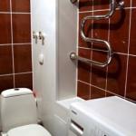 Как закрыть трубы в ванной?